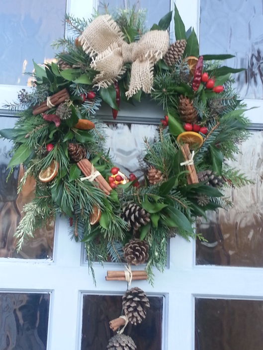 One of My Flower Patch wreaths on our front door .